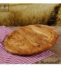 Planche à découper, forme ronde, accompagnée d'une rainure de jus en bois d'olivier